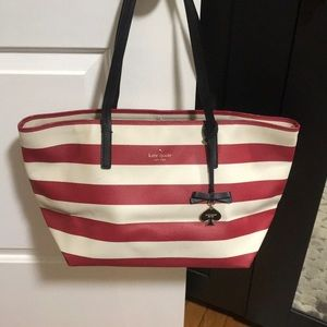 Red and white worn Kate spade tote
